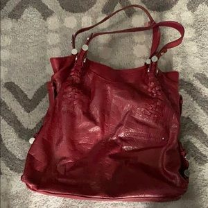 B. Makowsky red hobo bag